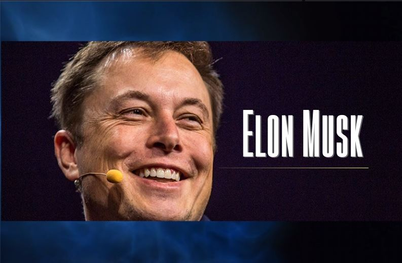 Elon Musk smiling on microphone